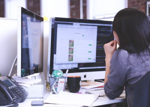 woman at desk working on website/SEO