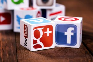cubes with google and facebook logo